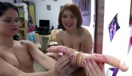 Two babes playing with a huge dildo and taking pictures of themselves