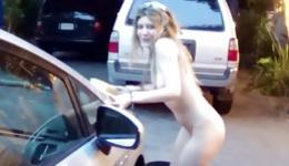 Marvelous and pornographic bitch undressing while washing the car