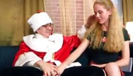 Blonde marvelous sweetheart giving the sweet blowjob to Santa's dick