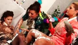 Sweet babes all dirty with cake pleasuring each other in a fierce way