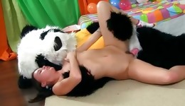 Hot young goddess undresses and fucks with big panda toy