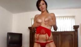 Stunning brunette in her red lingerie squeezing her boobs and playing