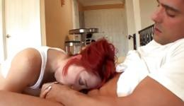 Red haired slut is getting on her knees and gets pounded rough inside her